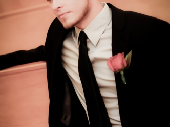 Posed wedding photography: young handsome groom.