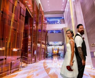 Studio Wedding Photography: bride and groom in chic hotel.