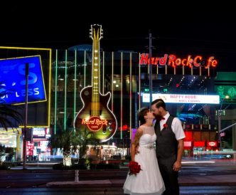 Studio Wedding Photography: bride and groom with Vegas night as backdrop.