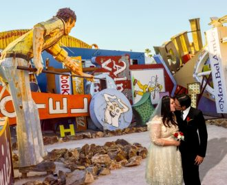 Studio Wedding Photography: bride and groom near an array of historic neon signs in Vegas.