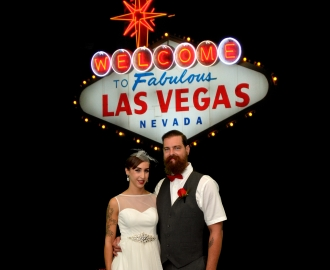 Studio Wedding Photography: bride and groom by Vegas sign.