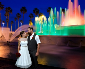 Studio Wedding Photography: newlyweds by romantic rainbow colored water fountains.