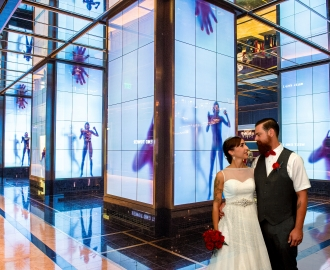 Studio Wedding Photography: upscale hotel is the backdrop for newlyweds kiss.