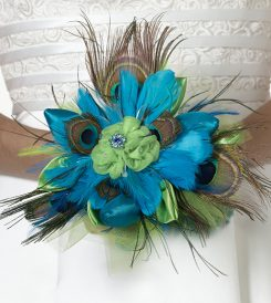 Peacock feather wedding bouquet from Lillian Rose collection.