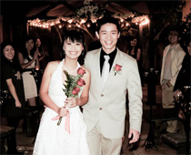 Asian newlyweds at their reception.