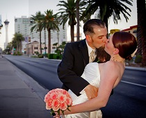 Newlyweds go for a deep dip kiss on Las Vegas Boulevard.