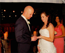 Bride and groom celebrate first dance at reception.