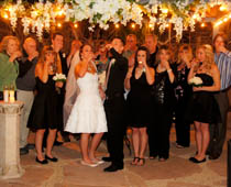 Garden wedding reception with toast to bride and groom at Mon Bel Ami Wedding Chapel in LAs Vegas.