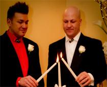 Gay wedding unity candle ceremony in wedding chapel.