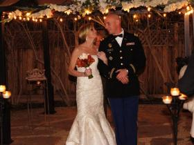 Marine and bride in gazebo at Mon Bel Ami Wedding Chapel.