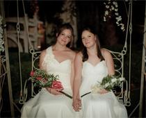 Lesbian wedding in chapel garden.