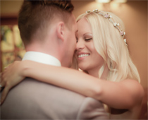 Beautiful bride gets her first kiss as wife of her new husband.