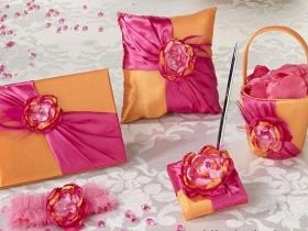 Pink and orange flower basket, ring pillow, garter and memory book with floral accent.