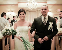 After exchanging vows, newlyweds walk happily down the aisle.