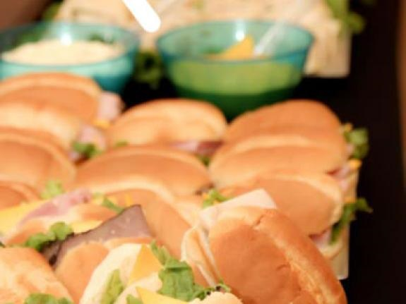 Ham, roast beef and turkey sandwiches at wedding reception.