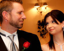 Bride and groom look in to each other's eyes and smile knowing they have just been married in our wedding chapel.