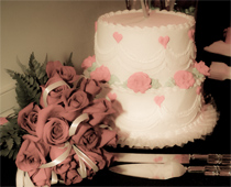 Pink rose bouquet and wedding cake ready for reception at Mon Bel Ami Wedding Chapel in Las Vegas.