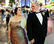 Just married couple strolls along the famous Las Vegas Strip.