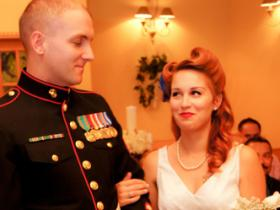 Marine in full attire accepts his bride-to-be at Mon Bel Ami Wedding Chapel in Las Vegas.