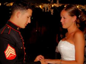 Groom in full military attire recites vows to his bride in beautiful white wedding dress at Mon Bel Ami Wedding Chapel Gazebo in Las Vegas.