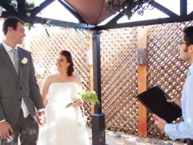 Couple exchanges their wedding vows with minister in the outdoor gazebo at Mon Bel Ami Wedding Chapel in Las Vegas.